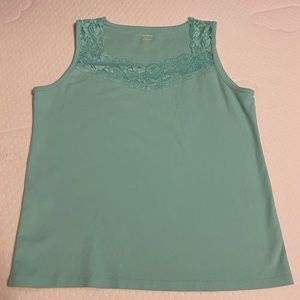 Sleeveless top with lace detail.